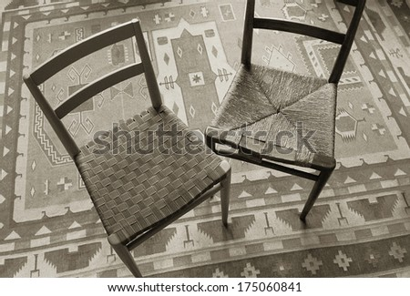 chairs being repaired with new weaving - stock photo