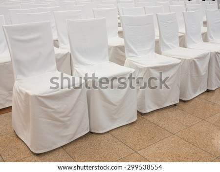 Chairs Covered With A White Fabric. Wedding Reception.