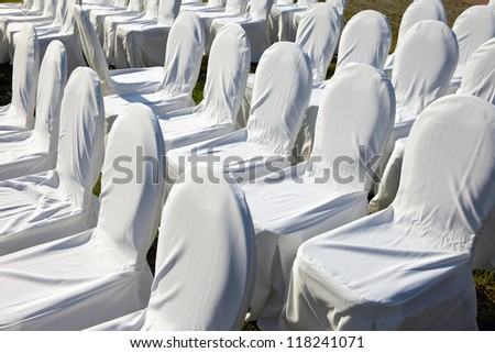 Chairs covered with white cloth, usually used for weddings