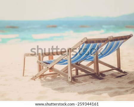 chairs for relaxing on the beach (retro style) - stock photo