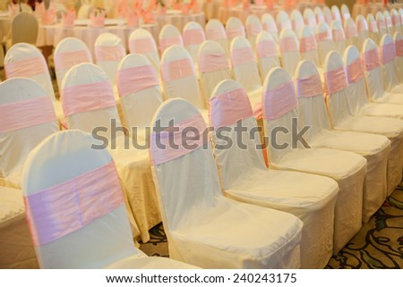 Chairs for the event or wedding reception party. Wedding table decorations in the restaurant. Valentine's Day dinner with elegant jewelry holiday heart. - stock photo