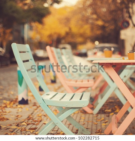 Chairs in autumn - stock photo