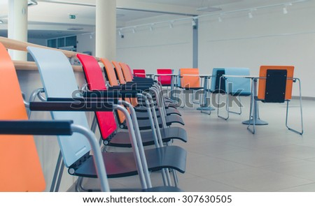 Chairs in empty business conference room interior.