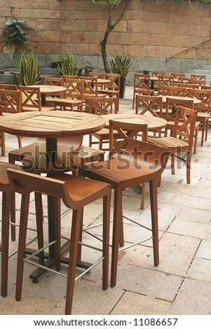 Chairs in Open Air Area at a Trendy Pub during a sunny day