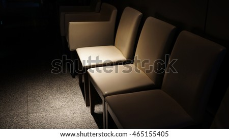 chairs in the darkness
