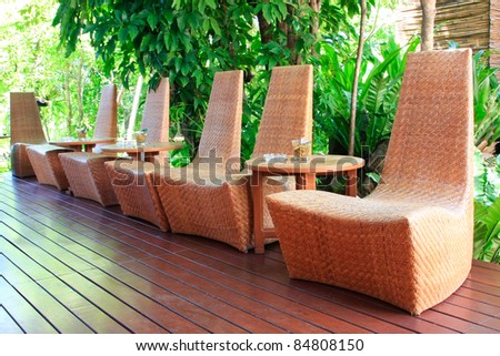 chairs in tropical garden - home exterior design - stock photo