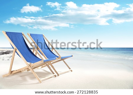 chairs of summer time on sand and sea landscape  - stock photo