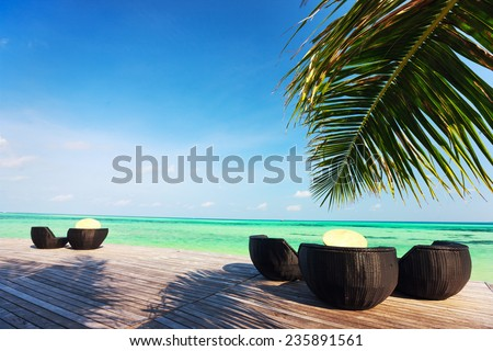 Chairs on a beautiful tropical beach at Maldives - stock photo