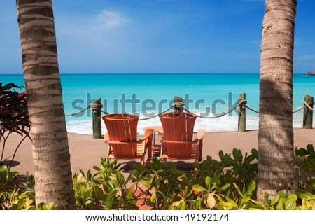 Chairs on beach patio - stock photo