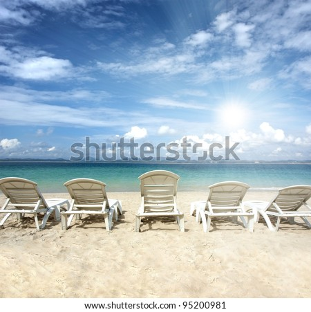 chairs on beach with blue sky for summer holiday - stock photo