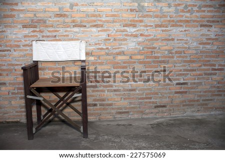 Chairs on brick red background.