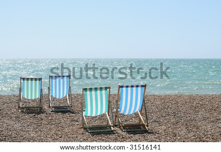 chairs on brighton beach, england