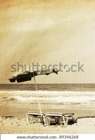 chairs on shore near sea in grunge and retro style - stock photo