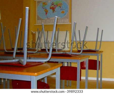 Chairs on tables in a school classroom