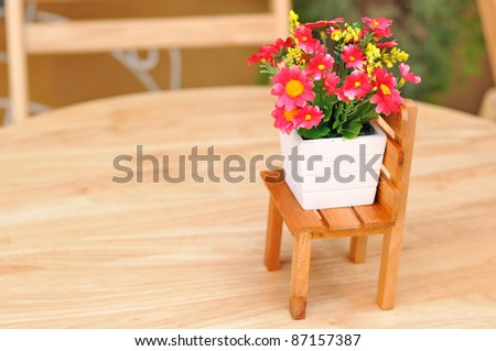 chairs on the patio with flowers in the summer - stock photo