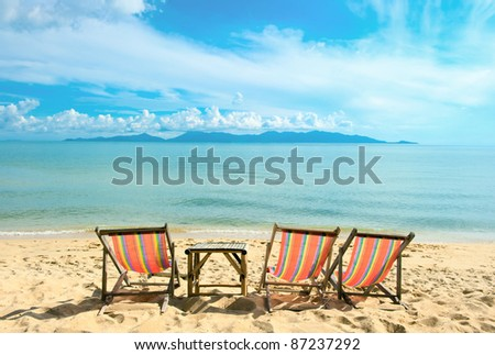 Chairs on the sandy beach near with sea