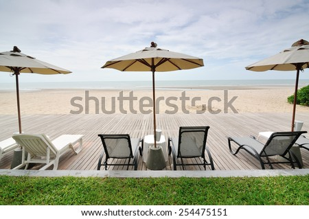 Chairs on white sand beach - stock photo