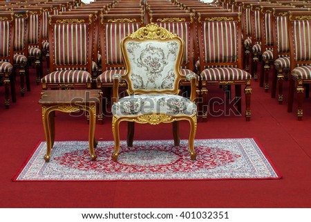 chairs pattern on red capet