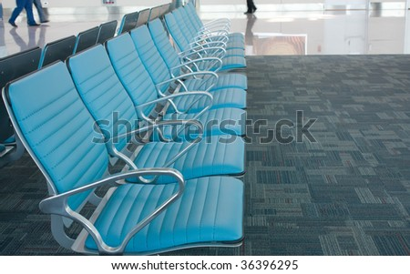 Chairs row in airport. Waiting space. - stock photo