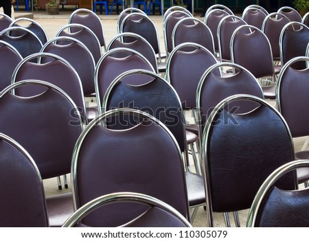 chairs set for an outdoor event - stock photo