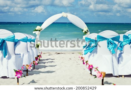 Chairs set up for beach wedding - stock photo