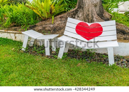 Chairs sitting on grass - stock photo