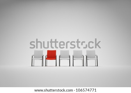 Chairs with outstanding red one - stock photo