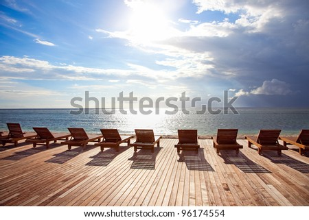 Chaise longue in sunset,on Trawangan beach,Gili island, Indonesia - stock photo