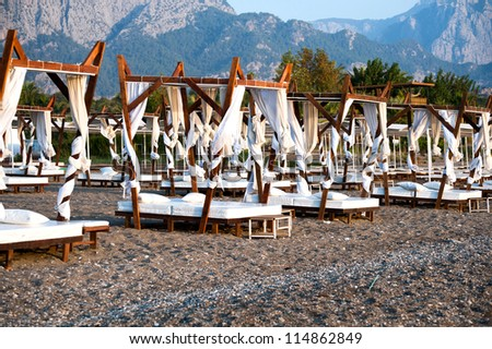 Chaise-longue on beach. Turkey. - stock photo
