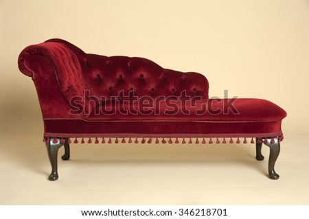 chaise longue seat covered in a dark red velvet