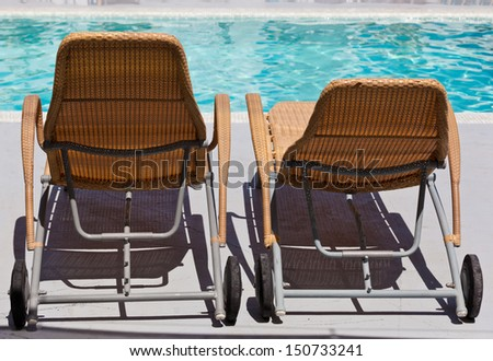 Chaise lounge by the pool - stock photo
