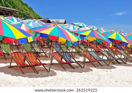 Chaise lounges on a tropical beach in Indian ocean - stock photo