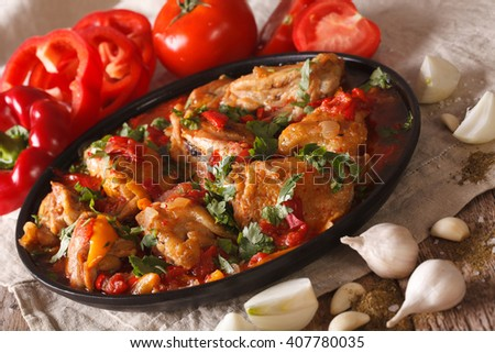 Chakhokhbili Chicken with ingredients on a table close-up. Horizontal - stock photo