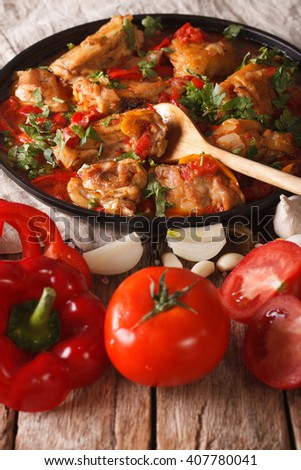 Chakhokhbili Chicken with ingredients on a table close-up. vertical - stock photo