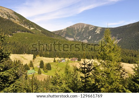 chalet and hill Snezka in the national park Krkonose Czech - stock photo