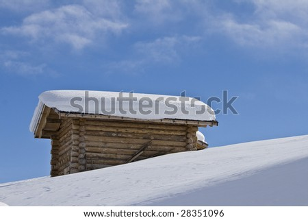 chalet in the snow, alps - stock photo