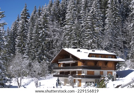 chalet in winter in the swiss Alps, Villars Switzerland - stock photo