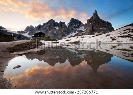 Chalet Segantini at the lake, Passo Rolle, Dolomites Alps, Italy - stock photo