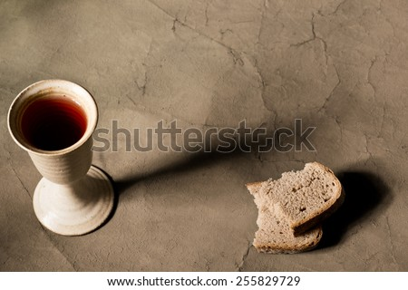 chalice of wine with bread  - stock photo