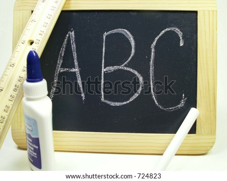 Chalk board, chalk, glue and ruler isolated on white with A B C written on chalk board. - stock photo