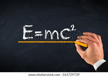 chalk board with hand and theory of relativity - stock photo