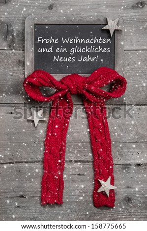 Chalk board with Merry Christmas message , santa and snowflakes on wooden background - stock photo