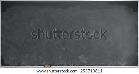 Chalk covered school blackboard, ideal for backgrounds - stock photo