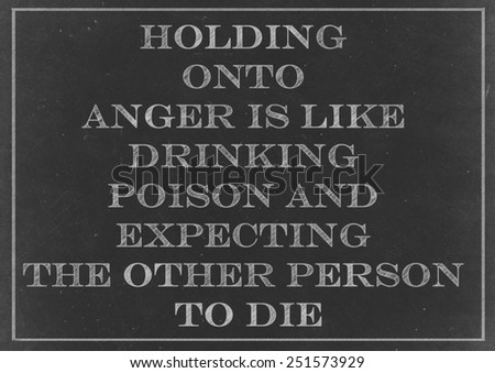 Chalk drawing - concept of Holding onto anger is like drinking poison and expecting the other person to die - stock photo