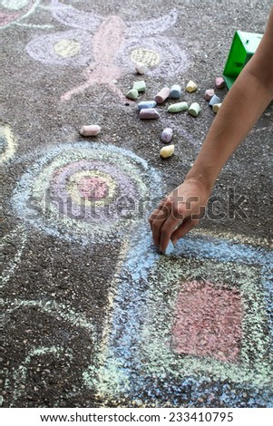 Chalk drawing hand outside on asphalt, woman hand.. - stock photo