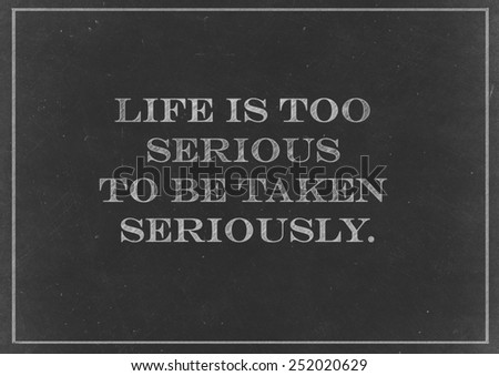 Chalk drawing -  Life is too serious to be taken seriously - stock photo