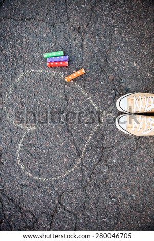 Chalk drawings on asphalt outdoors - stock photo