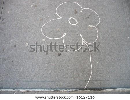 chalk flower on sidewalk - stock photo
