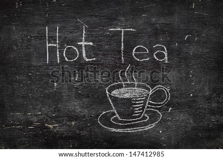 Chalk on black board: Hot Tea