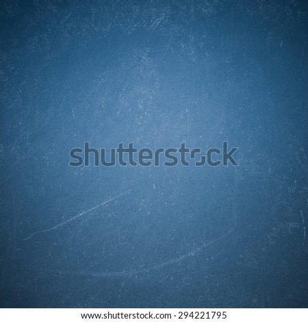Chalk rubbed out on blue blackboard - stock photo